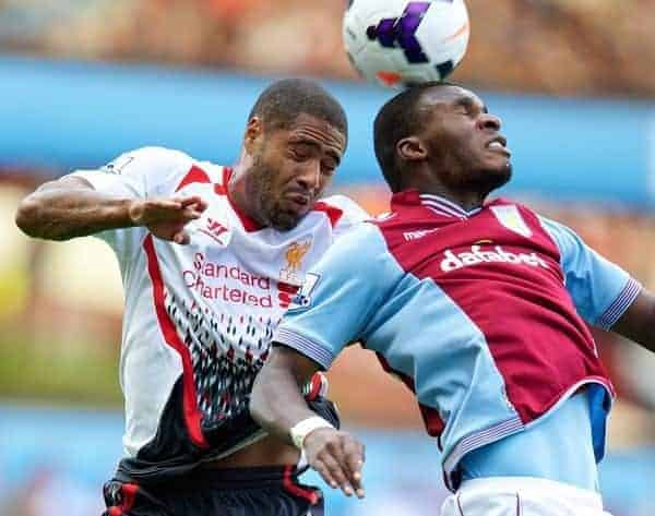 LIVERPOOL, ENGLAND - Saturday, August 24, 2013: Liverpool's Glen Johnson in action against Aston Villa's Christian Benteke during the Premiership match at Villa Park. (Pic by David Rawcliffe/Propaganda)