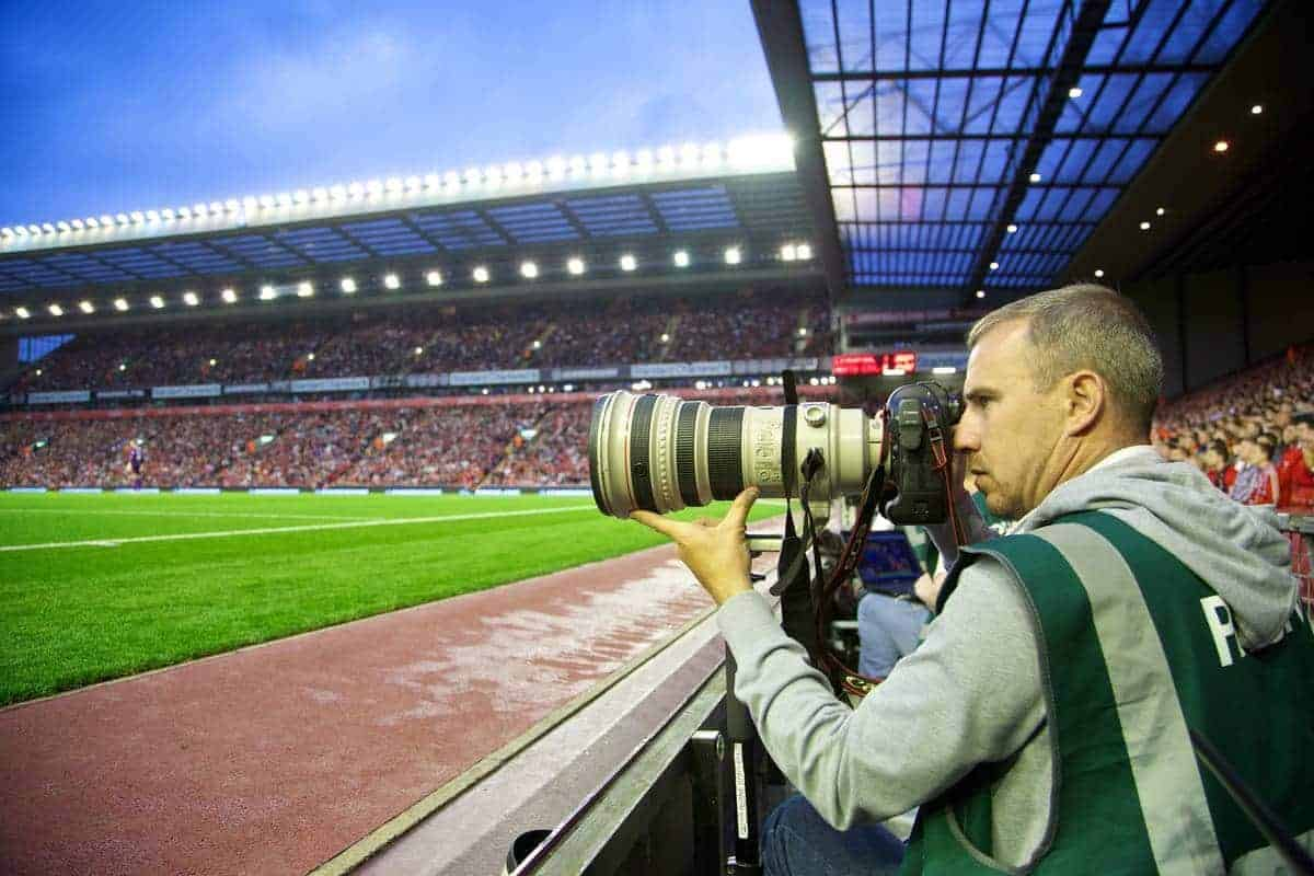 LIVERPOOL, ENGLAND - Tuesday, August 27, 2013: Press Association (PA) photographer Peter Byrne covers Liverpool versus Notts County during the Football League Cup 2nd Round match at Anfield. (Pic by David Rawcliffe/Propaganda)