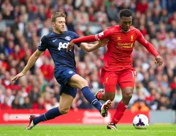 LIVERPOOL, ENGLAND - Sunday, September 1, 2013: Liverpool's Daniel Sturridge and Manchester United's Michael Carrick during the Premiership match at Anfield. (Pic by David Rawcliffe/Propaganda)