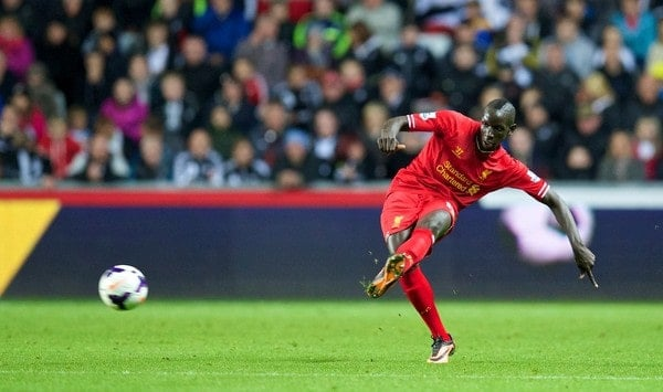 SWANSEA, WALES - Monday, September 16, 2013: Liverpool's Mamadou Sakho in action against Swansea City during the Premiership match at the Liberty Stadium. (Pic by David Rawcliffe/Propaganda)
