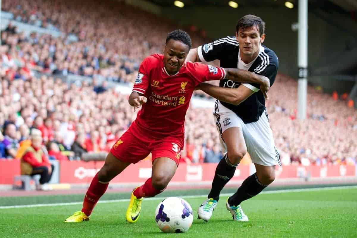 LIVERPOOL, ENGLAND - Saturday, September 21, 2013: Liverpool's Raheem Sterling and Southampton's Dejan Lovren during the Premiership match at Anfield. (Pic by David Rawcliffe/Propaganda)
