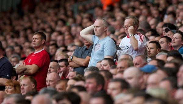 LIVERPOOL, ENGLAND - Saturday, September 21, 2013: Liverpool supporters on the Spion Kop look dejected as they watch their side lose 1-0 to Southampton during the Premiership match at Anfield. (Pic by David Rawcliffe/Propaganda)