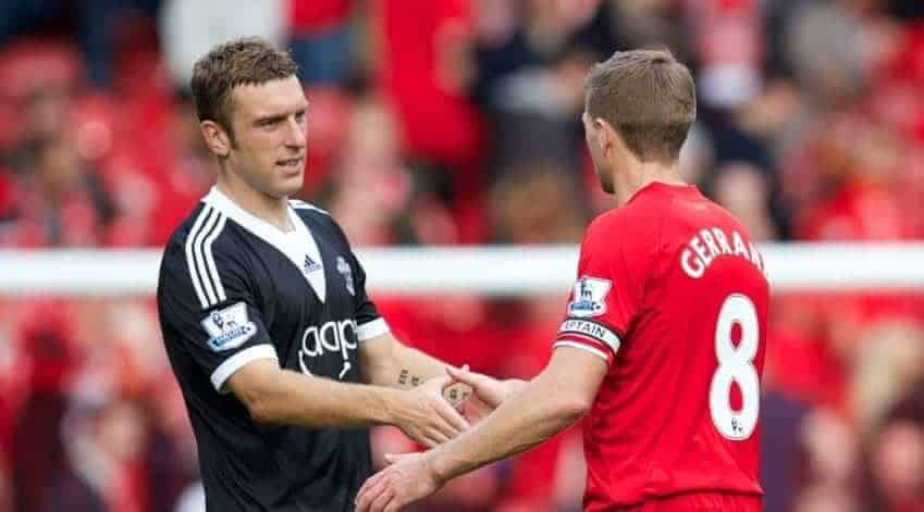 LIVERPOOL, ENGLAND - Saturday, September 21, 2013: Liverpool's captain Steven Gerrard shakes hands with Southampton's Rickie Lambert during the Premiership match at Anfield. (Pic by David Rawcliffe/Propaganda)