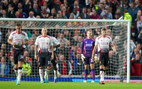 MANCHESTER, ENGLAND - Wednesday, September 25, 2013: Liverpool's captain Steven Gerrard looks dejected as Manchester United score the opening goal during the Football League Cup 3rd Round match at Old Trafford. (Pic by David Rawcliffe/Propaganda)