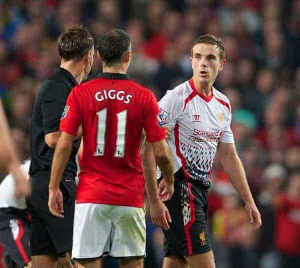 MANCHESTER, ENGLAND - Wednesday, September 25, 2013: Liverpool's Jordan Henderson and Manchester United's Ryan Giggs square put to each other during the Football League Cup 3rd Round match at Old Trafford. (Pic by David Rawcliffe/Propaganda)