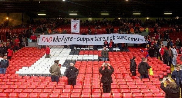 LIVERPOOL, ENGLAND - Saturday, October 26, 2013: Liverpool supporters protest against modern football and high ticket prices with a banner 'FAO Mr. Ayre - supporters not customers' after the 3-1 victory over West Bromwich Albion during the Premiership match at Anfield. (Pic by David Rawcliffe/Propaganda)