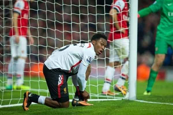 LONDON, ENGLAND - Saturday, November 2, 2013: Liverpool's Daniel Sturridge ties his boot laces against Arsenal during the Premiership match at the Emirates Stadium. (Pic by David Rawcliffe/Propaganda)