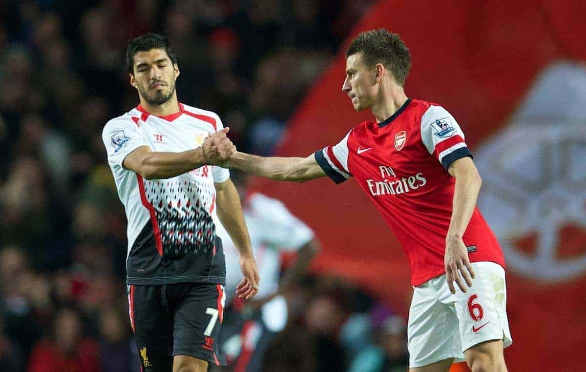 LONDON, ENGLAND - Saturday, November 2, 2013: Liverpool's Luis Suarez looks dejected as he shakes hands with Arsenal's Laurent Koscielny following his side's 2-0 defeat during the Premiership match at the Emirates Stadium. (Pic by David Rawcliffe/Propaganda)
