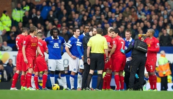 LIVERPOOL, ENGLAND - Saturday, November 23, 2013: Players react after Luis Suarez was tackled during the 221st Merseyside Derby Premiership match against Everton at Goodison Park. (Pic by David Rawcliffe/Propaganda)