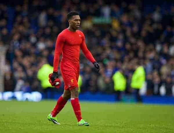 LIVERPOOL, ENGLAND - Saturday, November 23, 2013: Liverpool's Daniel Sturridge takes his shirt off to give to a supporter after his side's 3-3 draw with Everton during the 221st Merseyside Derby Premiership match at Goodison Park. (Pic by David Rawcliffe/Propaganda)