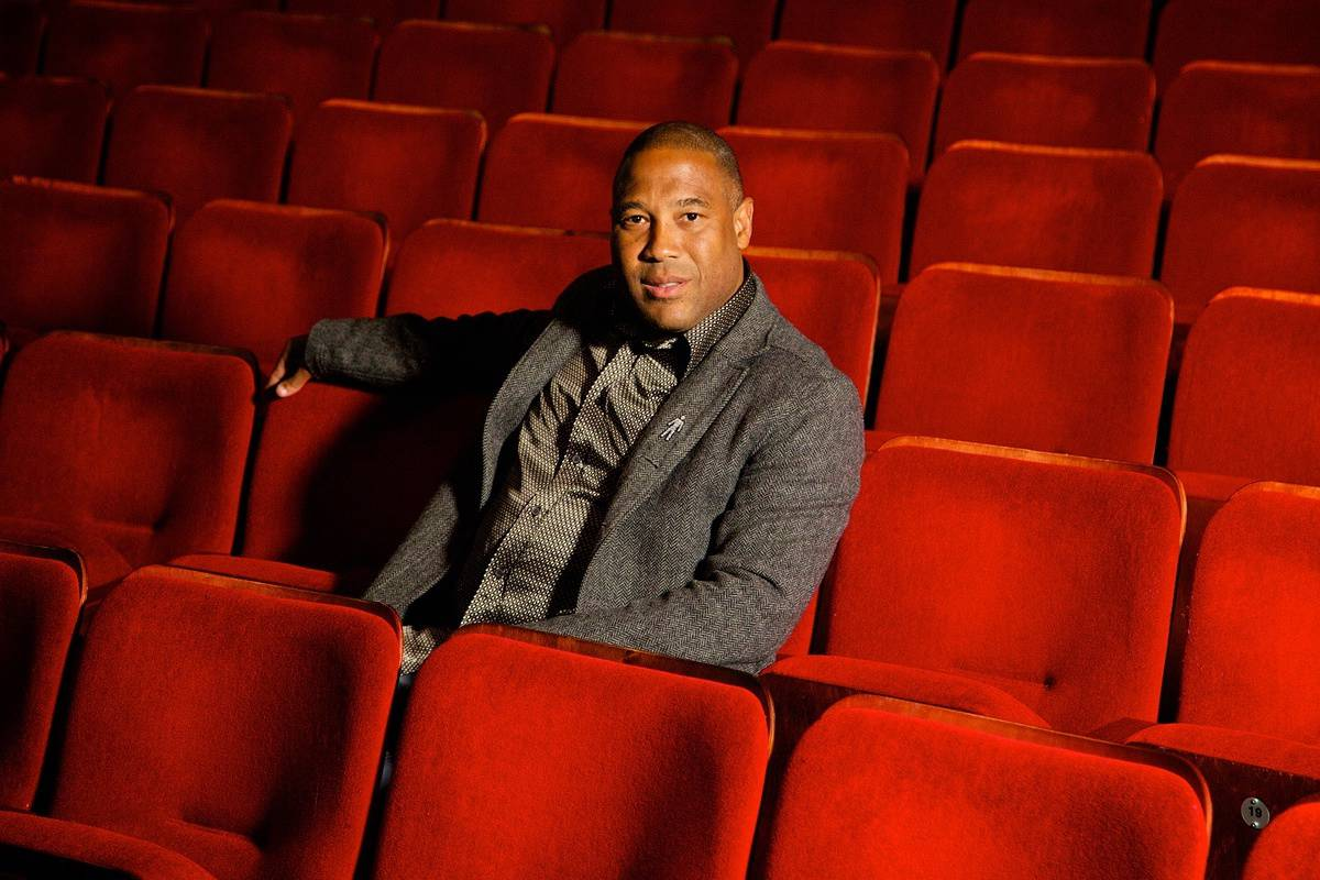 LIVERPOOL, ENGLAND - Tuesday, December 3, 2013: Former Liverpool and England player John Barnes sits in the seats at the Epstein Theatre in Liverpool before his one man show - An Audience with Liverpool Legend John Barnes. (Pic by David Rawcliffe/Propaganda)