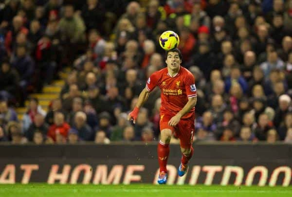 LIVERPOOL, ENGLAND - Wednesday, December 4, 2013: Liverpool's Luis Suarez on his way to scoring his third goal against Norwich City during the Premiership match at Anfield. (Pic by David Rawcliffe/Propaganda)