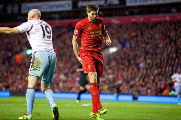 LIVERPOOL, ENGLAND - Saturday, December 7, 2013: Liverpool's captain Steven Gerrard pulls up injured against West Ham United during the Premiership match at Anfield. (Pic by David Rawcliffe/Propaganda)