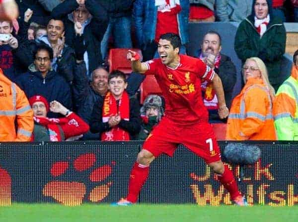 LIVERPOOL, ENGLAND - Saturday, December 21, 2013: Liverpool's Luis Suarez celebrates scoring the first goal against Cardiff City during the Premiership match at Anfield. (Pic by David Rawcliffe/Propaganda)