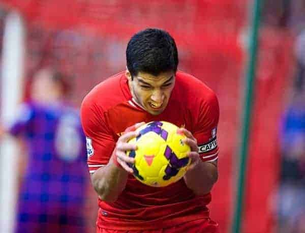 LIVERPOOL, ENGLAND - Saturday, December 21, 2013: Liverpool's Luis Suarez looks dejected after missing a chance for this third goal against Cardiff City during the Premiership match at Anfield. (Pic by David Rawcliffe/Propaganda)