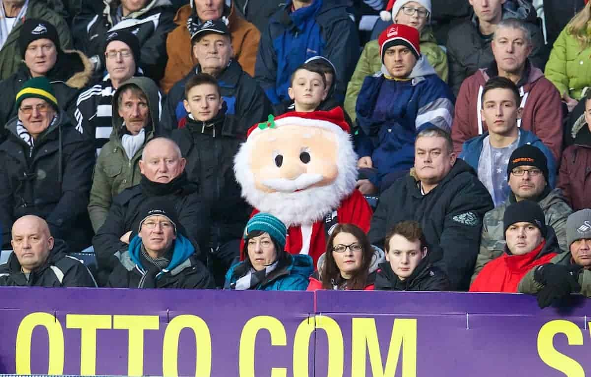 SWANSEA, WALES - Sunday, December 22, 2013: A happy looking Father Christmas looks on as Swansea City take on Everton during the Premiership match at the Liberty Stadium. (Pic by David Rawcliffe/Propaganda)