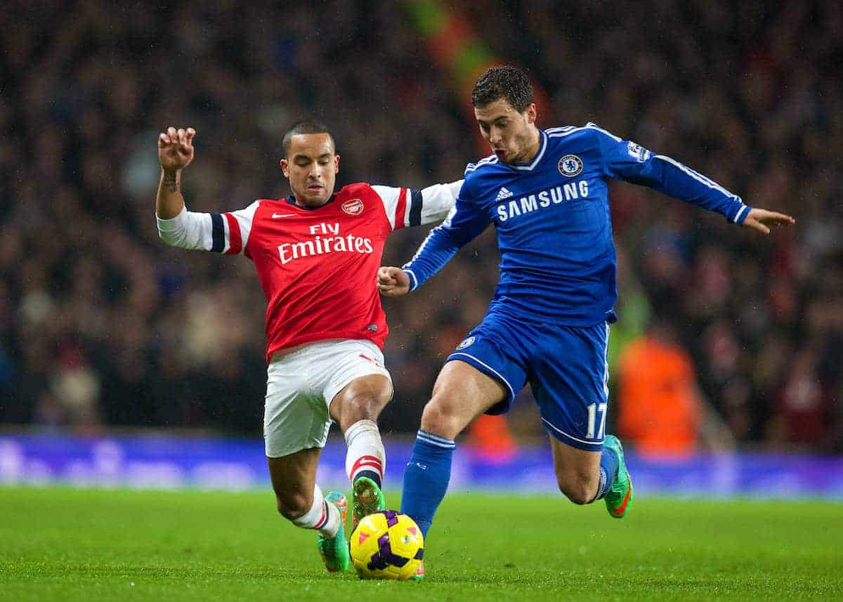LONDON, ENGLAND - Monday, December 23, 2013: Arsenal's Theo Walcott in action against Chelsea's Eden Hazard during the Premiership match at the Emirates Stadium. (Pic by David Rawcliffe/Propaganda)