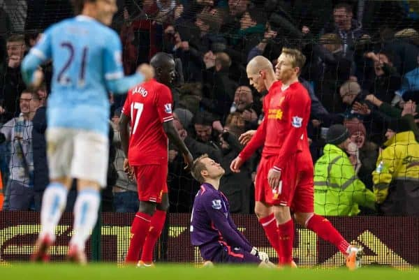 MANCHESTER, ENGLAND - Boxing Day Thursday, December 26, 2013: Liverpool's goalkeeper Simon Mignolet looks dejected as Manchester City score the second goal to make the score 2-1 during the Premiership match at the City of Manchester Stadium. (Pic by David Rawcliffe/Propaganda)