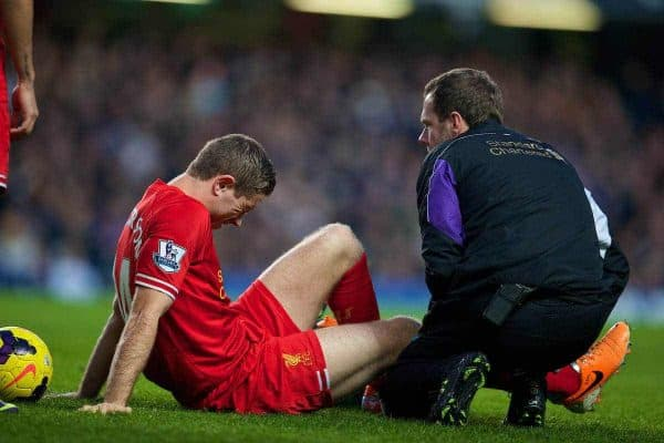 LONDON, ENGLAND - Sunday, December 29, 2013: Liverpool's Jordan Henderson is treated for an injury by physiotherapist Chris Morgan against Chelsea during the Premiership match at Stamford Bridge. (Pic by David Rawcliffe/Propaganda)