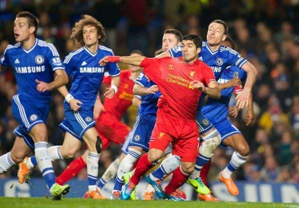 LONDON, ENGLAND - Sunday, December 29, 2013: Liverpool's Luis Suarez has his shirt pulled by Chelsea's captain John Terry but no penalty is given during the Premiership match at Stamford Bridge. (Pic by David Rawcliffe/Propaganda)
