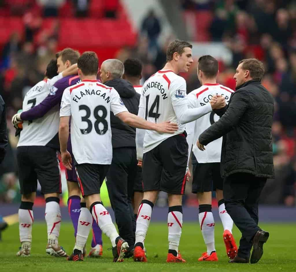 MANCHESTER, ENGLAND - Sunday, March 16, 2014: Liverpool's Jordan Henderson and manager Brendan Rodgers celebrate after a 3-0 victory over Manchester United during the Premiership match at Old Trafford. (Pic by David Rawcliffe/Propaganda)