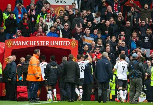 MANCHESTER, ENGLAND - Sunday, March 16, 2014: Liverpool's Jon Flanagan celebrates as the Manchester United supporters watch the victorious players walk off the pitch during the Premiership match at Old Trafford. (Pic by David Rawcliffe/Propaganda)