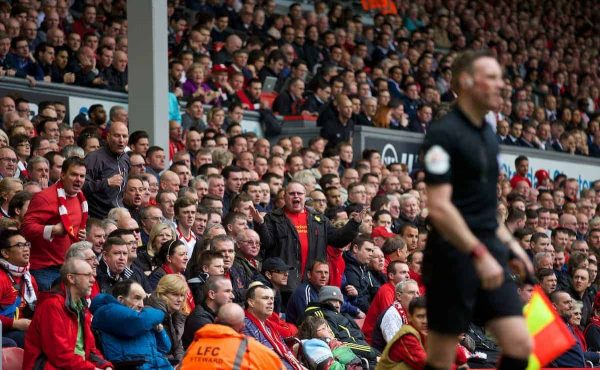 LIVERPOOL, ENGLAND - Sunday, March 30, 2014: A Liverpool supporter berates the linesman during the Premiership match against Tottenham Hotspur at Anfield. (Pic by David Rawcliffe/Propaganda)