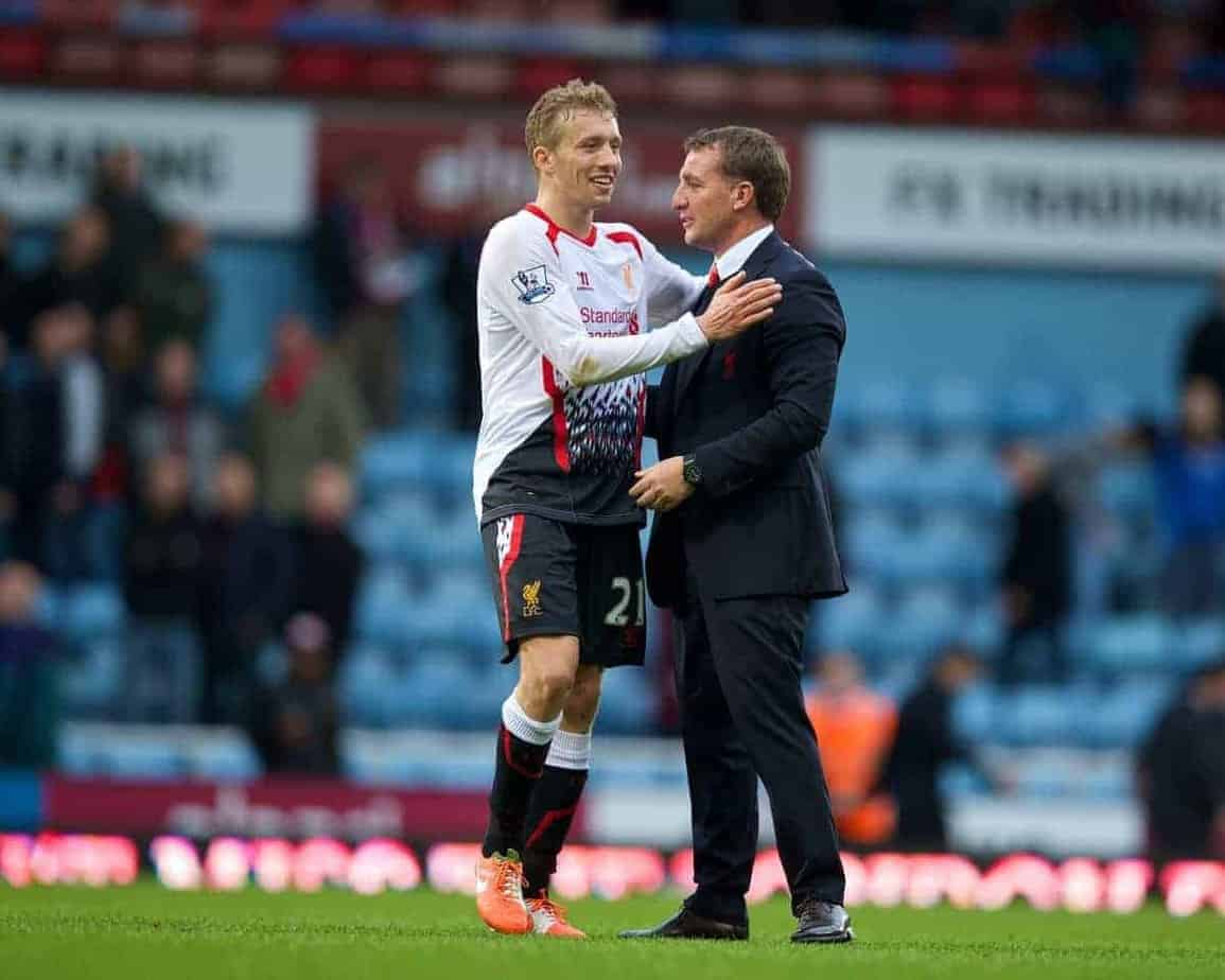 LONDON, ENGLAND - Sunday, April 6, 2014: Liverpool's Lucas Leiva celebrates with manager Brendan Rodgers after beating West Ham United 2-1 during the Premiership match at Upton Park. (Pic by David Rawcliffe/Propaganda)