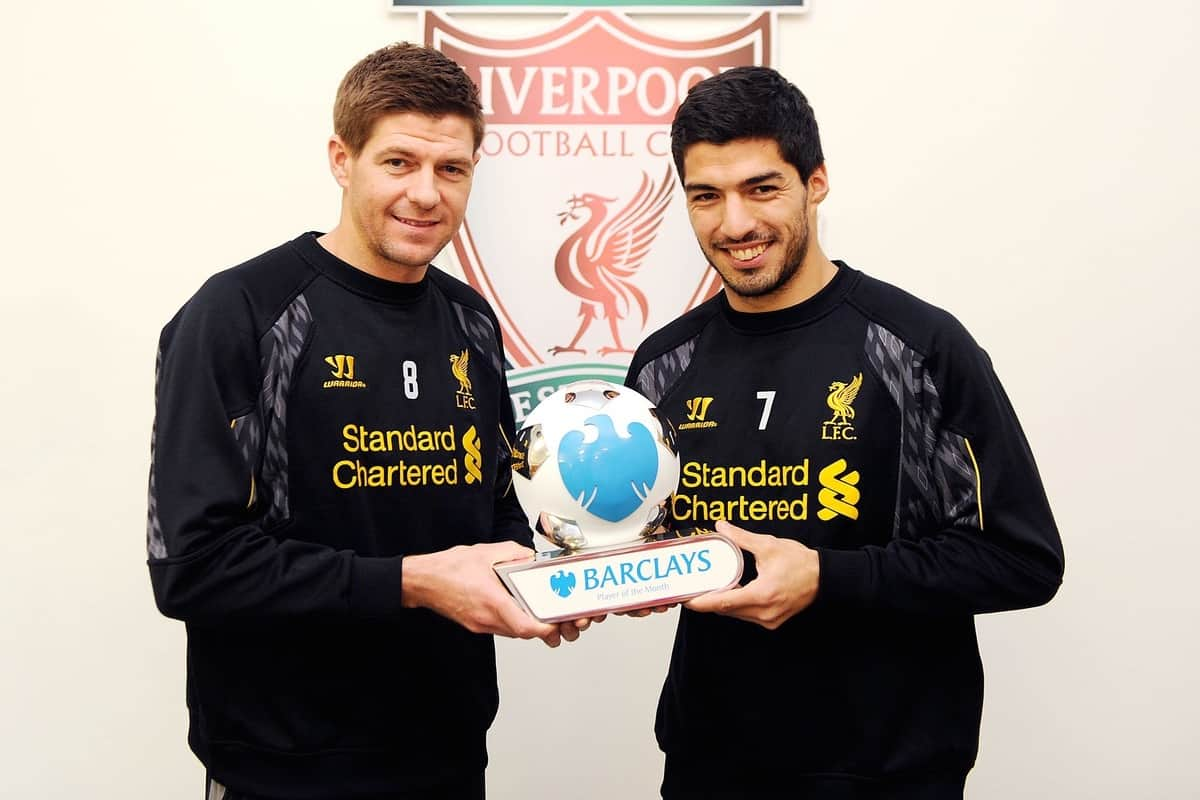 LIVERPOOL, ENGLAND - Friday, April 11, 2014: Liverpool's Luis Suarez and Steven Gerrard with the Barclays Player of the Month award for March which was shared between them. (Pic by Liverpool FC/Action Images)