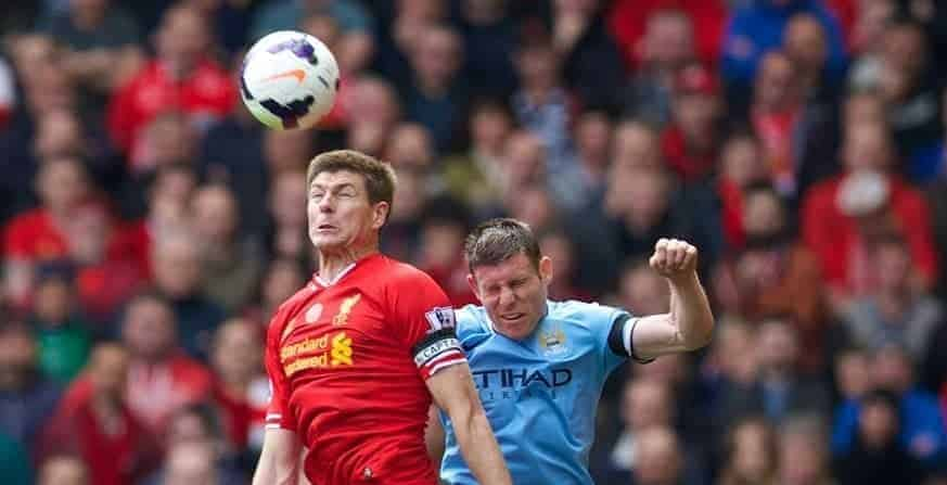 LIVERPOOL, ENGLAND - Sunday, April 13, 2014: Liverpool's captain Steven Gerrard in action against Manchester City's James Milner during the Premiership match at Anfield. (Pic by David Rawcliffe/Propaganda)