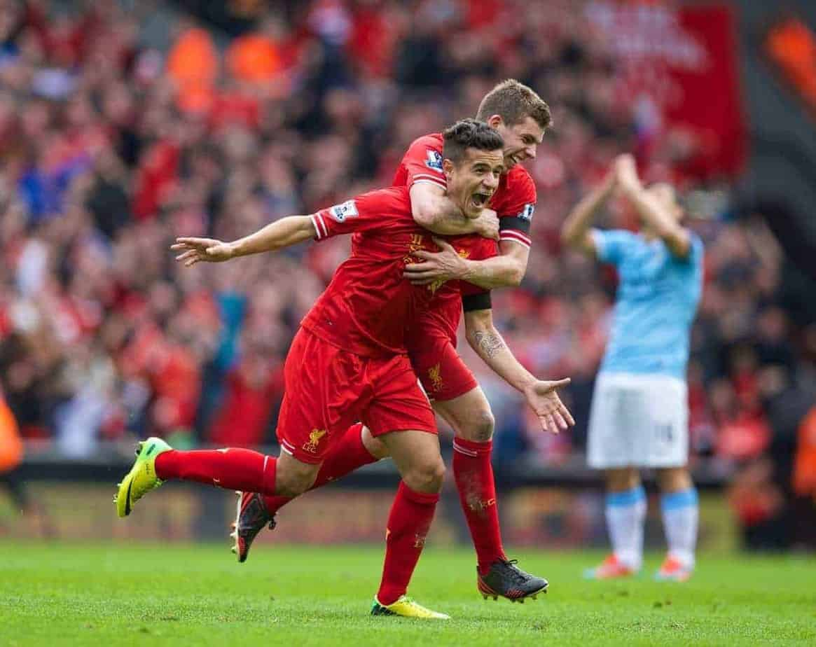 LIVERPOOL, ENGLAND - Sunday, April 13, 2014: Liverpool's Philippe Coutinho Correia celebrates scoring the winning third goal against Manchester City with team-mate Jon Flanagan during the Premiership match at Anfield. (Pic by David Rawcliffe/Propaganda)