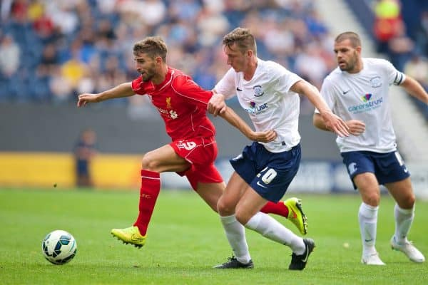 PRESTON, ENGLAND - Saturday, July 19, 2014: Liverpool's Fabio Borini in action against Preston North End's Ben Davies during a preseason friendly match at Deepdale Stadium. (Pic by David Rawcliffe/Propaganda)