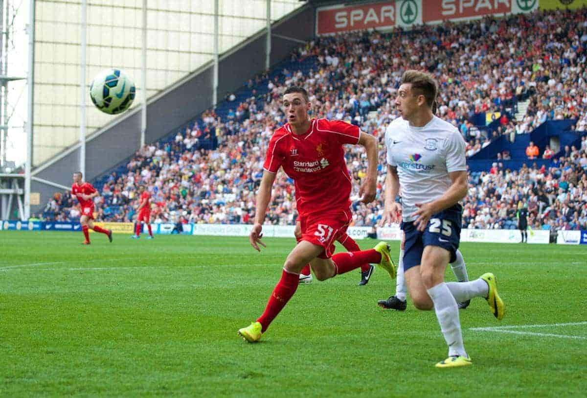 PRESTON, ENGLAND - Saturday, July 19, 2014: Liverpool's Lloyd Jones in action against Preston North End's Jordan Hugill during a preseason friendly match at Deepdale Stadium. (Pic by David Rawcliffe/Propaganda)