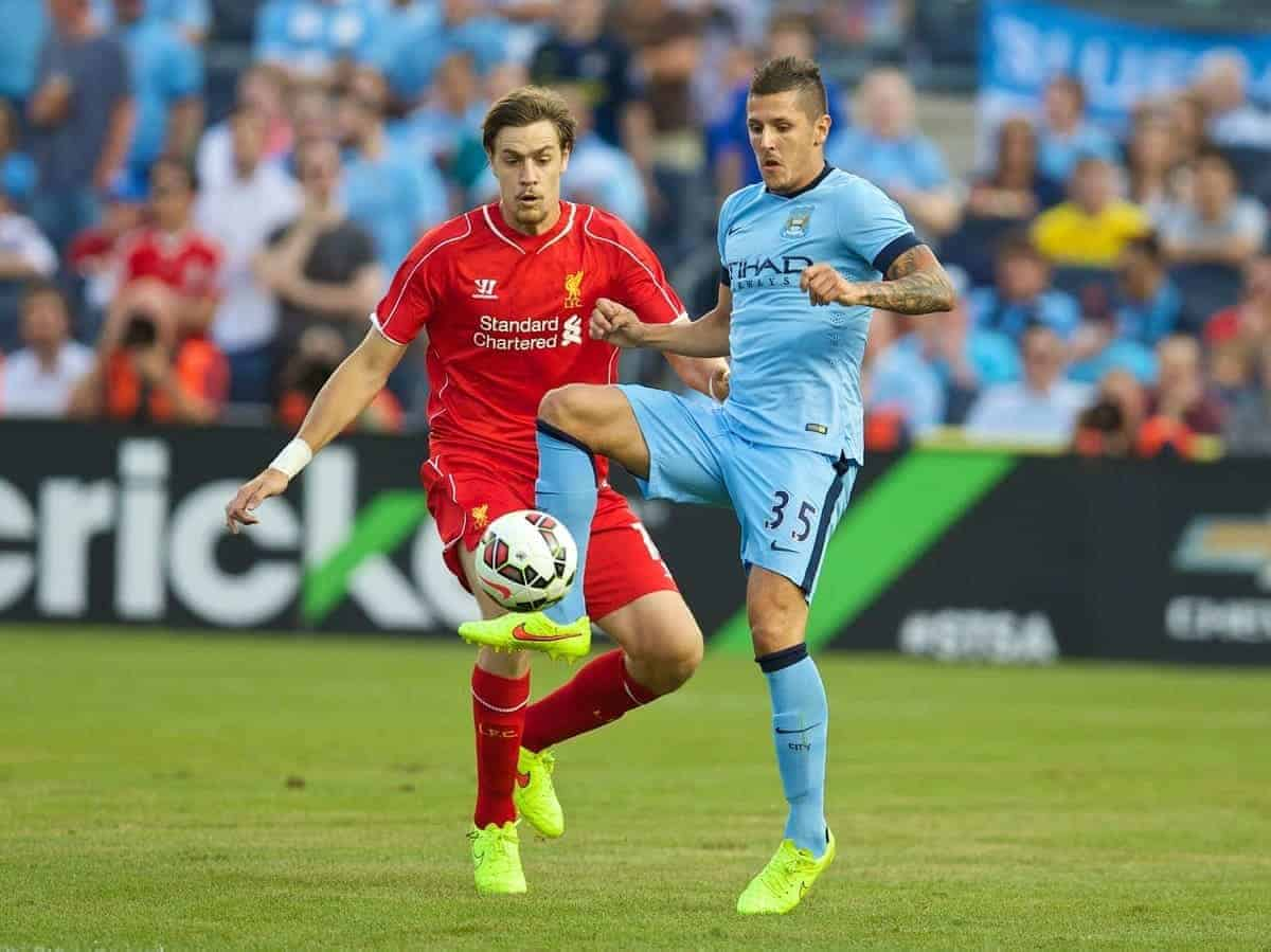 NEW YORK, USA - Wednesday, July 30, 2014: Liverpool's Sebastian Coates in action against Manchester City's Stevan Jovetic during the International Champions Cup Group B match at the Yankee Stadium on day ten of the club's USA Tour. (Pic by David Rawcliffe/Propaganda)
