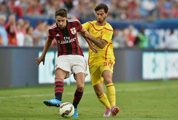 CHARLOTTE, USA - Saturday, August 2, 2014: Liverpool's 'Suso' Jesus Joaquin Fernandez Saenz De La Torre in action against AC Milan's Mattia De Sciglio during the International Champions Cup Group B match at the Bank of America Stadium on day thirteen of the club's USA Tour. (Pic by David Rawcliffe/Propaganda)