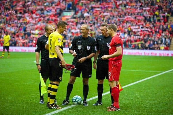 LIVERPOOL, ENGLAND - Sunday, August 10, 2014: Liverpool's captain Steven Gerrard and Borussia Dortmund's Sebastian Kehl during a preseason friendly match at Anfield. (Pic by David Rawcliffe/Propaganda)