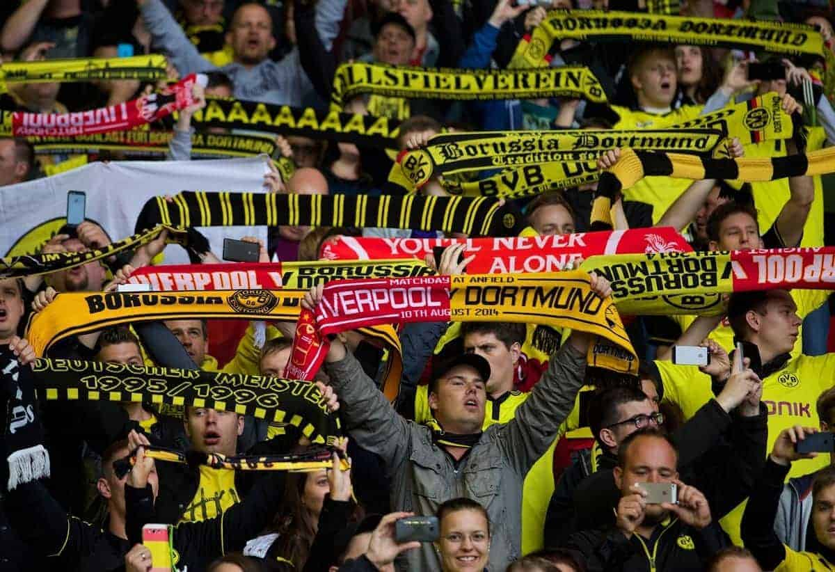 LIVERPOOL, ENGLAND - Sunday, August 10, 2014: Borussia Dortmund supporters sing 'You'll Never Walk Alone' during a preseason friendly match against Liverpool at Anfield. (Pic by David Rawcliffe/Propaganda)