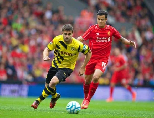 LIVERPOOL, ENGLAND - Sunday, August 10, 2014: Borussia Dortmund's Sokratis Papastathopoulos in action against Liverpool's Philippe Coutinho Correia during a preseason friendly match at Anfield. (Pic by David Rawcliffe/Propaganda)