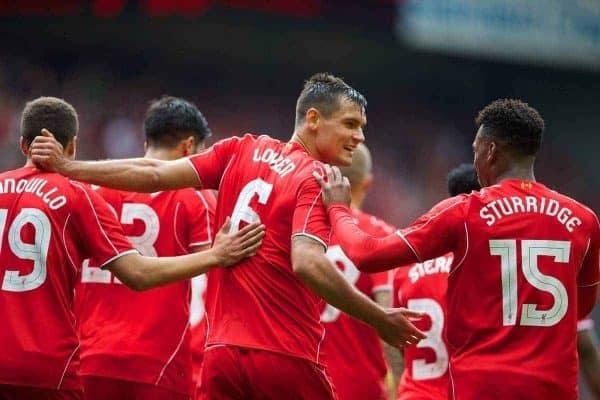 Liverpool's Dejan Lovren celebrates scoring the second goal against Borussia Dortmund during a preseason friendly match at Anfield. (Pic by David Rawcliffe/Propaganda)