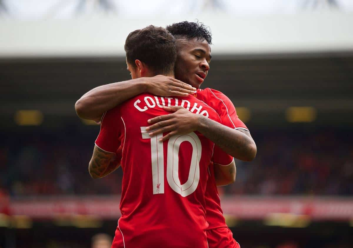 LIVERPOOL, ENGLAND - Sunday, August 10, 2014: Liverpool's Philippe Coutinho Correia celebrates scoring the third goal against Borussia Dortmund with team-mate Raheem Sterling during a preseason friendly match at Anfield. (Pic by David Rawcliffe/Propaganda)
