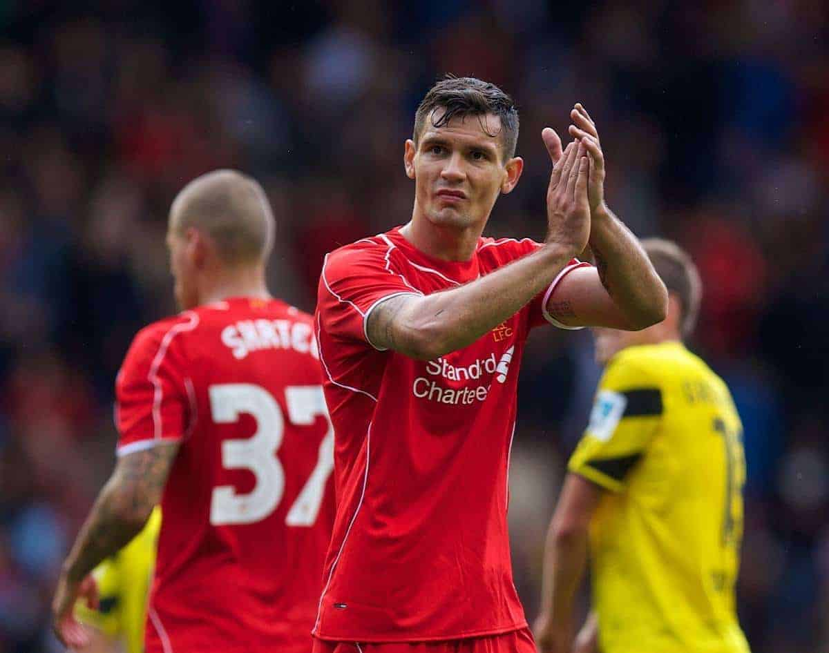 LIVERPOOL, ENGLAND - Sunday, August 10, 2014: Liverpool's Dejan Lovren applauds the supporters after his first game, and goal, for the club during a preseason friendly match against Borussia Dortmund at Anfield. (Pic by David Rawcliffe/Propaganda)