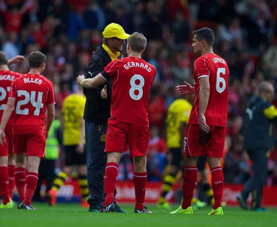 LIVERPOOL, ENGLAND - Sunday, August 10, 2014: Liverpool's captain Steven Gerrard and Borussia Dortmund's head coach Jurgen Klopp during a preseason friendly match at Anfield. (Pic by David Rawcliffe/Propaganda)