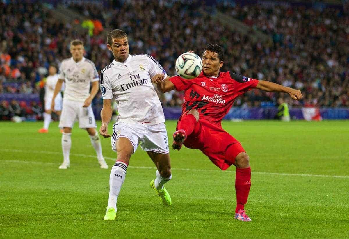 CARDIFF, WALES - Tuesday, August 12, 2014: Sevilla's Carlos Bacca in action against Real Madrid's Pepe during the UEFA Super Cup at the Cardiff City Stadium. (Pic by David Rawcliffe/Propaganda)