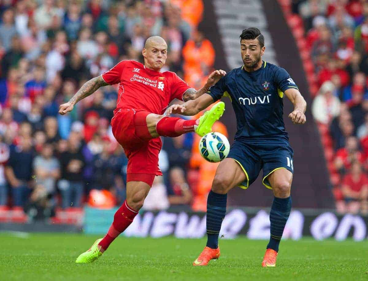 LIVERPOOL, ENGLAND - Sunday, August 17, 2014: Liverpool's Martin Skrtel in action against Southampton's Graziano Pelle during the Premier League match at Anfield. (Pic by David Rawcliffe/Propaganda)