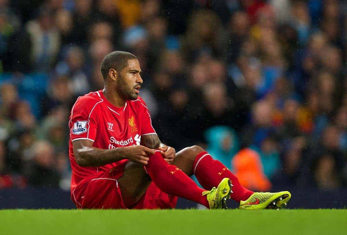 MANCHESTER, ENGLAND - Monday, August 25, 2014: Liverpool's Glen Johnson injured during the Premier League match against Manchester City at the City of Manchester Stadium. (Pic by David Rawcliffe/Propaganda)
