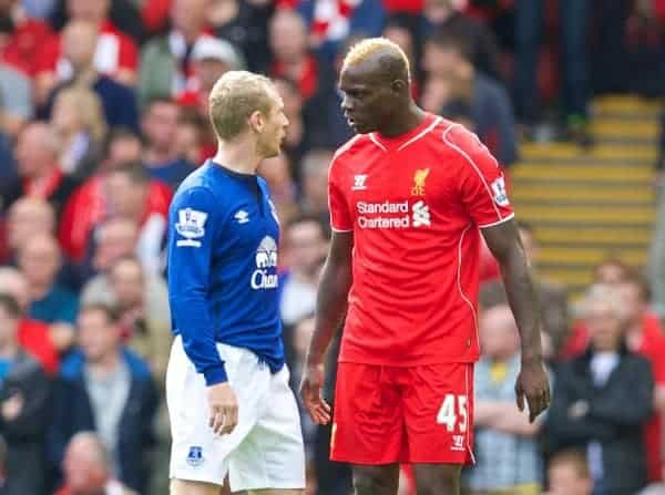 LIVERPOOL, ENGLAND - Saturday, September 27, 2014: Liverpool's Mario Balotelli clashes with Everton's Tony Hibbert during the Premier League match at Anfield. (Pic by David Rawcliffe/Propaganda)