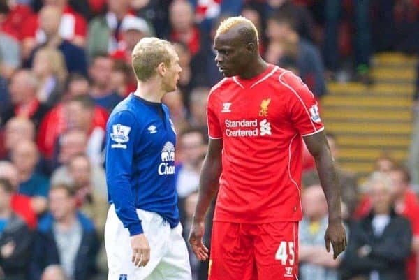 Liverpool's Mario Balotelli clashes with Everton's Tony Hibbert during the Premier League match at Anfield. (Pic by David Rawcliffe/Propaganda)