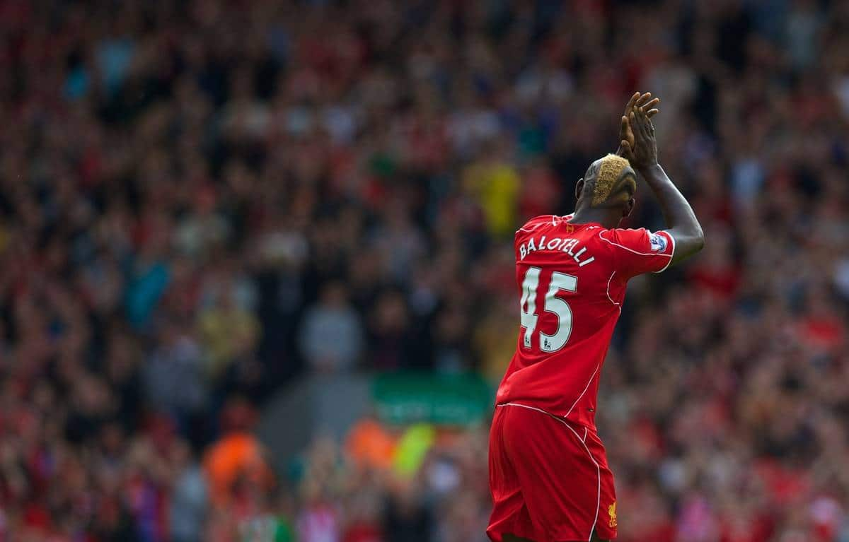 LIVERPOOL, ENGLAND - Saturday, September 27, 2014: Liverpool's Mario Balotelli applauds the supporters as he is substituted against Everton during the Premier League match at Anfield. (Pic by David Rawcliffe/Propaganda)