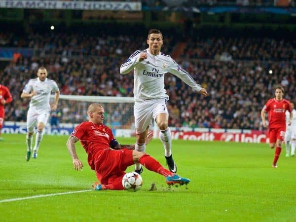 MADRID, SPAIN - Tuesday, November 4, 2014: Liverpool's captain Martin Skrtel tackles Real Madrid's Cristiano Ronaldo during the UEFA Champions League Group B match at the Estadio Santiago Bernabeu. (Pic by David Rawcliffe/Propaganda)