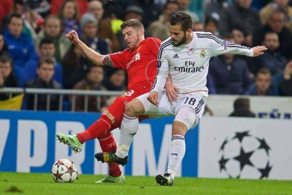 MADRID, SPAIN - Tuesday, November 4, 2014: Liverpool's Alberto Moreno in action against Real Madrid's Nacho during the UEFA Champions League Group B match at the Estadio Santiago Bernabeu. (Pic by David Rawcliffe/Propaganda)